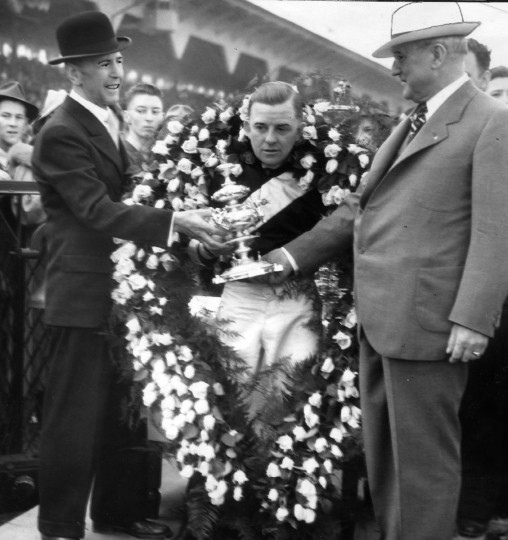 Presenting the historic Woodlawn Vase in 1937 to Charles E. McLane, jockey Charley Kurtsinger and Mayor Howard Jackson. (Baltimore Sun file photo)
