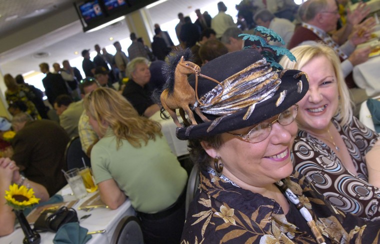 Diana Salatti of Baltimore sports a special hat to the Alibi Breakfast at Pimlico. On her right is Geraldine Sporney of Yorkshire, England. (Jed Kirschbaum/Baltimore Sun)