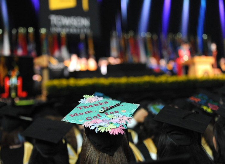 THANKS, COFFEE! - On Commencement Day, Towson University graduates express their creativity by decorating their mortarboards with messages of thanks to parents, friends, the Almighty, and even coffee. Each cap has been named in the spirit of the graduate's message. (Algerina Perna/Baltimore Sun)