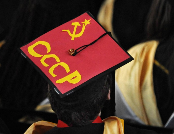 MESSAGES - On Commencement Day, Towson University graduates express their creativity by decorating their mortarboards with messages of thanks to parents, friends, the Almighty, and even coffee. (Algerina Perna/Baltimore Sun)