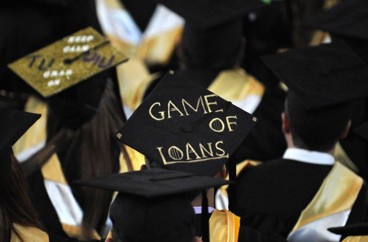 REALITY CHECK - On Commencement Day, Towson University graduates express their creativity by decorating their mortarboards with messages of thanks to parents, friends, the Almighty, and even coffee. (Algerina Perna/Baltimore Sun)
