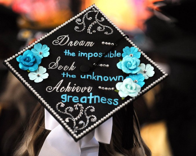 WORDS TO LIVE BY... - On Commencement Day, Towson University graduates express their creativity by decorating their mortarboards with messages of thanks to parents, friends, the Almighty, and even coffee. (Algerina Perna/Baltimore Sun)