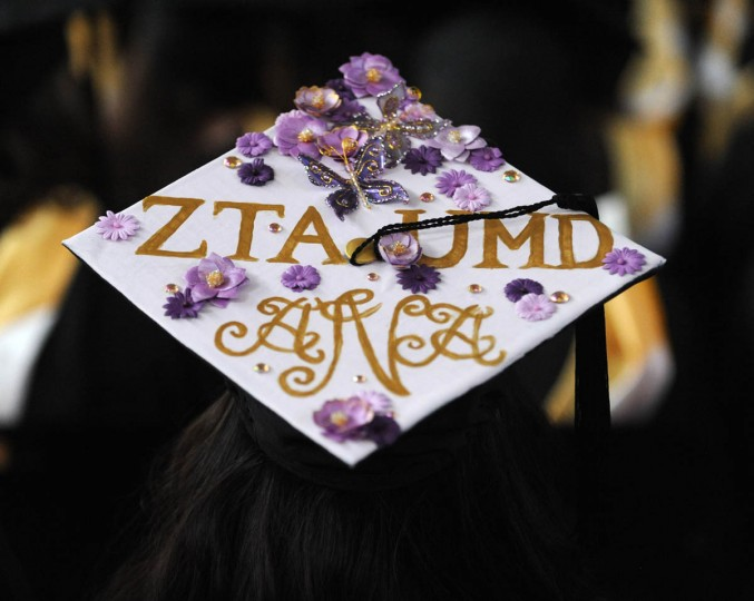 GREEK GODDESS - On Commencement Day, Towson University graduates express their creativity by decorating their mortarboards with messages of thanks to parents, friends, the Almighty, and even coffee. (Algerina Perna/Baltimore Sun)