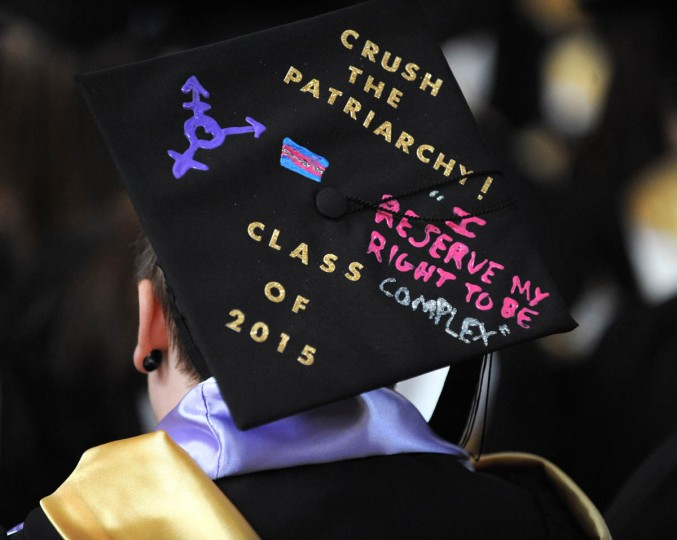 MULTI-FACETED - On Commencement Day, Towson University graduates express their creativity by decorating their mortarboards with messages of thanks to parents, friends, the Almighty, and even coffee. (Algerina Perna/Baltimore Sun)