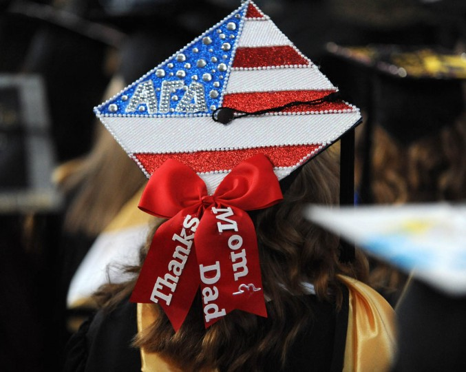 ALL AMERICAN - On Commencement Day, Towson University graduates express their creativity by decorating their mortarboards with messages of thanks to parents, friends, the Almighty, and even coffee. (Algerina Perna/Baltimore Sun)
