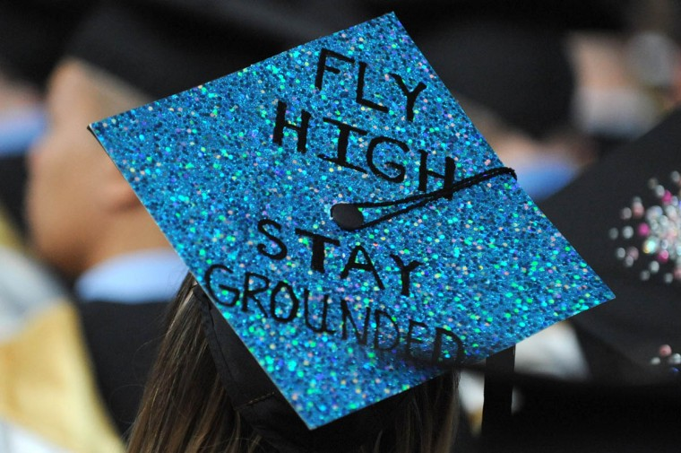 YIN AND YANG - On Commencement Day, Towson University graduates express their creativity by decorating their mortarboards with messages of thanks to parents, friends, the Almighty, and even coffee. (Algerina Perna/Baltimore Sun)