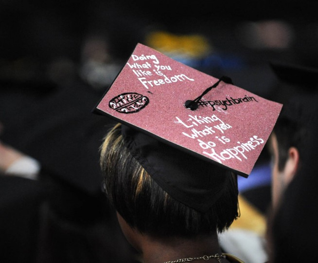 LIVING THE LIFE - On Commencement Day, Towson University graduates express their creativity by decorating their mortarboards with messages of thanks to parents, friends, the Almighty, and even coffee. (Algerina Perna/Baltimore Sun)