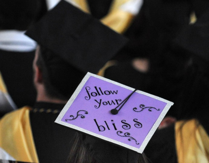 NEW AGE - On Commencement Day, Towson University graduates express their creativity by decorating their mortarboards with messages of thanks to parents, friends, the Almighty, and even coffee. (Algerina Perna/Baltimore Sun)