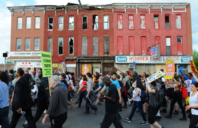 05/02/15: Marchers head north on Pennsylvania Ave toward North Ave after Saturday's rally at War Memorial Plaza. (Jerry Jackson/Baltimore Sun)