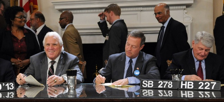 Left to right, Thomas V. Mike Miller, Jr., Senate President, smiles as Gov. Martin O'Malley and Michael E. Busch, House Speaker, sign SB 278 and HB 227 Maryland Employment Advancement Right Now (EARN) Program into law in the Governor's reception room. Kim Hairston/Baltimore Sun Staff