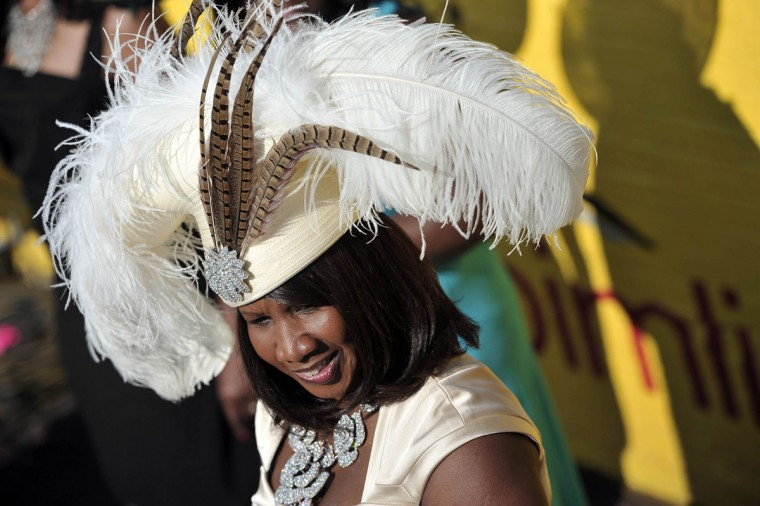 "Marjae Hicks, owner of See the Difference/Hats by Marjae in Westminster, shows off one of her creations, ""Marjae Special,"" at Pimlico Race Course. (Kim Hairston/Baltimore Sun)"