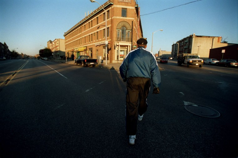 11/13/01: Dr. Calvin W. Burnett, 69 takes a walk to the Inner Harbor and back to the Coppin campus two or three mornings a week. Burnett crosses North Ave. at Pennsylvania Ave. (Kim Hairston/staff)