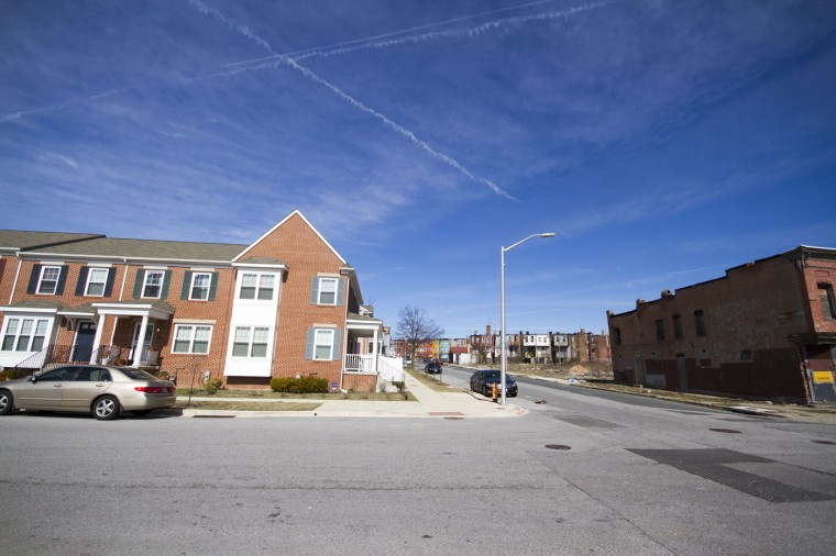 3/2015: A newer development of homes at Bakers View - an 87-home development targeting low-middle income families. Colorful shops and rowhomes sit dilapidated in the background along North Ave. (Kalani Gordon/Baltimore Sun)