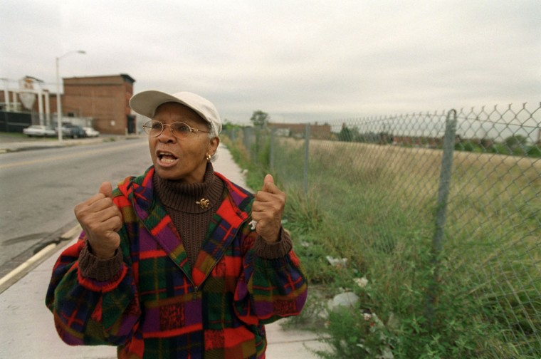 10/9/02: Ruby Glover speaks passionately about the jazz clubs that once drew great musicians and many patrons to Pennsylvania Avenue. Two clubs, Tijuana and Le Coq D'Or, were located in the vacant lot to the right. (Kim Hairston/staff)