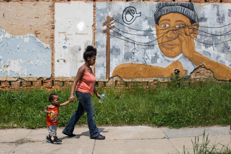 A woman walks down Riggs Avenue in the Sandtown-Windchester neighborhood on May 4, 2015 in Baltimore, Md. (Jessica Koscielniak/McClatchy DC/TNS)