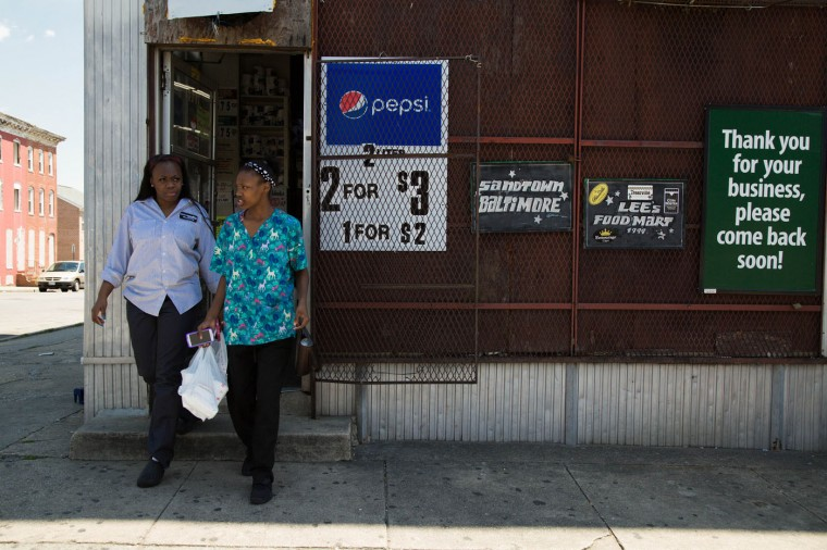 People leave a corner store in the Sandtown-Windchester neighborhood on May 4, 2015 in Baltimore, Md. (Jessica Koscielniak/McClatchy DC/TNS)