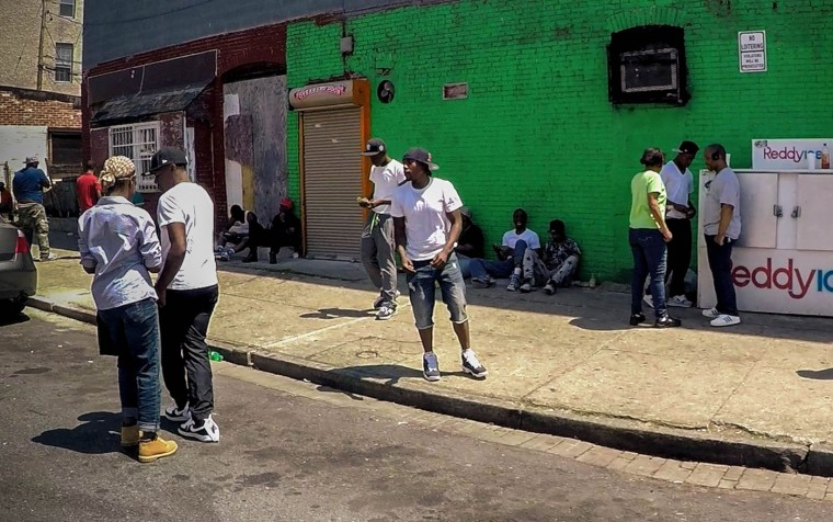 People loiter outside Lauren's Mini Mart at north Carey St. and Laurens St., a popular corner where sold drugs are allegedly sold in the Sandton-Winchester neighborhood on May 4, 2015 in Baltimore, Md. (Jessica Koscielniak/McClatchy DC/TNS)