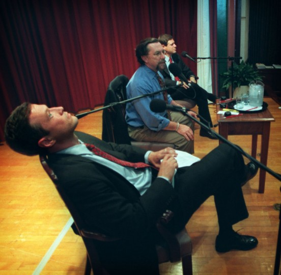 Mayoral candidate Martin O'Malley (L) relaxes between segments of the debate between himself and David F. Tufaro (R) on Wednesday evening at the Enoch Pratt Free Library. WJHU radio talk show host Marc Steiner (center) moderated the debate. Staff photo/Doug Kapustin