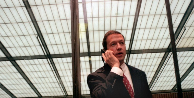 Mayor's First Month-- Mayor Martin O'Malley takes a phone call in the student center before leaving a breakfast at the Annual Mayor's Basketball Academy at Coppin State College. Jed Kirschbaum, Staff