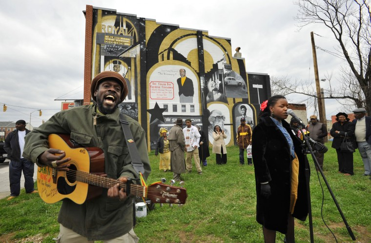 3/30/09: Jahiti of Brown Fish, left, and spoken word artist B-FLY. at microphone at right, performed Monday at the dedication of the Alvin Kirby Brunson mural by artist Donald Tyson-Bey in the 2000 block of Pennsylvania Avenue. The Brunson family and the Pennsylvania Avenue Redevelopment Collaborative hosted the event to celebrate the life and work of historian and educator Alvin Kirby Brunson, who dedicated his life to African-American history in the Pennsylvania Ave. corridor, and died one year ago when the building he was renovating for his museum collapsed. (Amy Davis/Baltimore Sun)