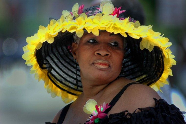 Bobbie McKinney of Baltimore makes a flowery hat herself, shows up at Flower Mart, comes to Westside Preakness Parade, and goes to Preakness. Since she was 9-year-old, her father took her to see Preakness, so this is an exciting time for her. (Chiaki Kawajiri/Baltimore Sun)