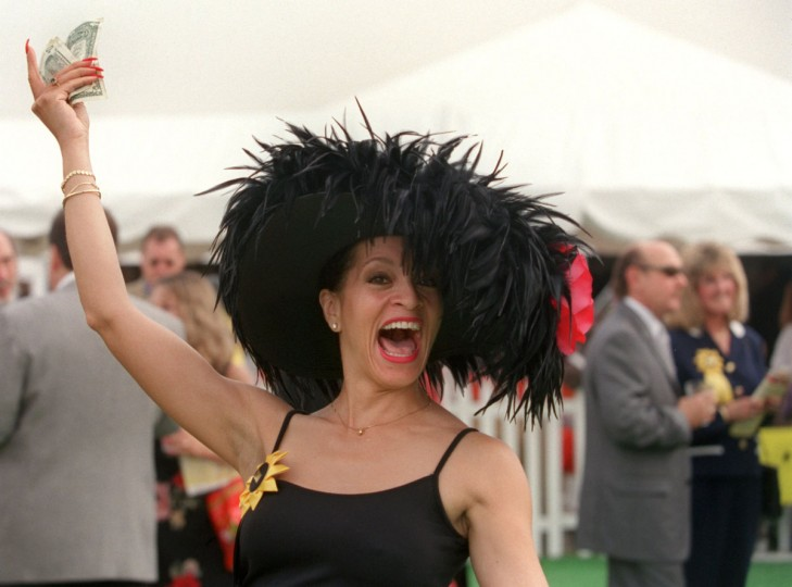 Carol McKenzie shows off her hand-made hot pink with black ostrich feather hat at the Preakness. (Linda Coan O'Kresik/Baltimore Sun)