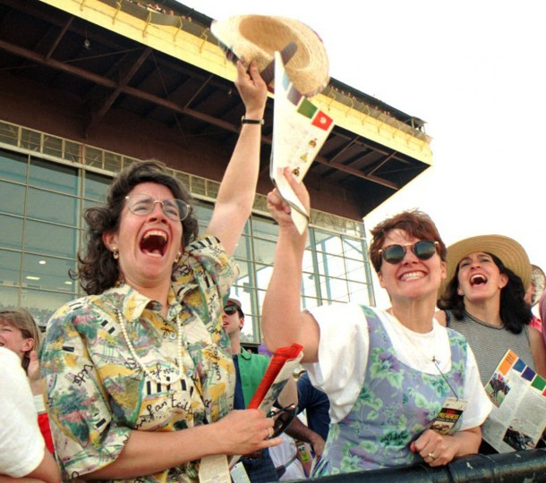 Kelly Hunter of Bedford NY and Loren Mitchell of Bangor Maine cheer on the horses in the Grandstand. (Mark Bugnaski/Baltimore Sun, 1993)