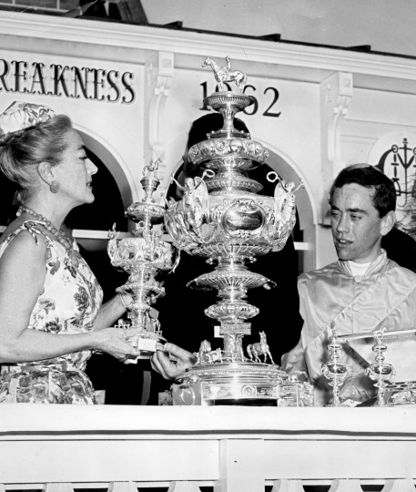 Actress Joan Crawford presents the Preakness trophy to jockey John L. Rotz, rider of 10 Greek Money the 1962 Preakness winner. (Clarence B. Garrett/ Baltimore Sun)