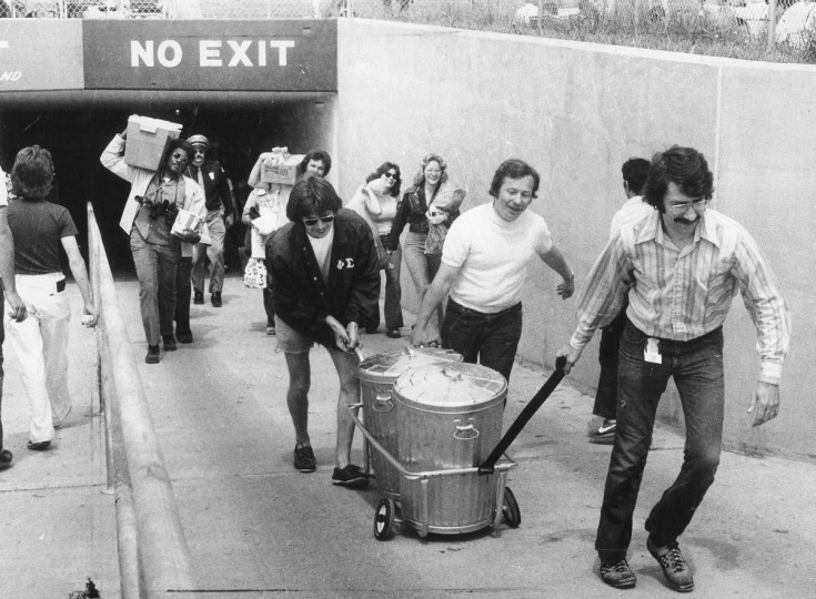 Race goers bring in their provisions for the day by whatever means necessary at the 1975 Preakness. (Baltimore Sun file photo)