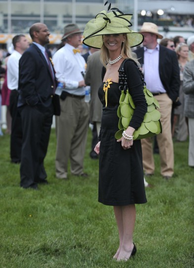 Lori Heinz, 37, Detroit, wears a chartreuse hat trimmed in black in the corporate tent area. 134th Preakness Stakes. (Kim Hairston/Baltimore Sun)
