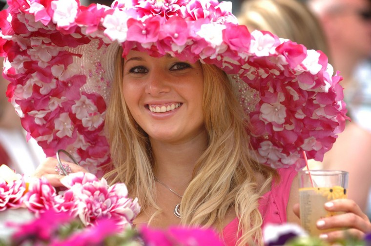 Leah Baker wears a floral hat made up of faux flowers. The 131st running of the Preakness Stakes at Pimlico Race Course. (Doug Kapustin/Baltimore Sun)