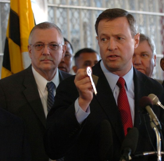 Governor Martin O'Malley holds ceremonial key given to him at press conference for closing of the 130 year old House of Corrections in 2007. In background, on left, is acting commissioner of the Department of Corrections John Rowley. Jed Kirschbaum, Staff