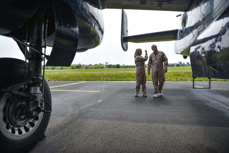Pilot Beth Jenkins, left, second in command, and crew member Bruce Pauley look over a vintage 1944 B-25 bomber before flying from the Culpeper Regional Airport on May 6, 2015 in Culpeper, Va. The vintage war planes will take part in the Arsenal of Democracy World War II Victory Capitol Flyover on Friday. The planes will fly in formation above Washington, D.C., to commemorate the 70th anniversary of the allied victory in Europe. (Michael E. Ruane/The Washington Post)
