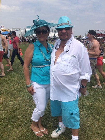 "This is the first time at the Preakness for Millie Rivera, 52, and Juan ""Rodfather"" Rodriguez, 48, of Woodbridge, Virginia. They have attended the Kentucky Derby and Belmont, so ""this is the year that we finish,"" Rodriguez said. Rodriguez is the mastermind behind the matching outfits; they've worn other coordinating colors to past races. (Quinn Kelley/Baltimore Sun)"