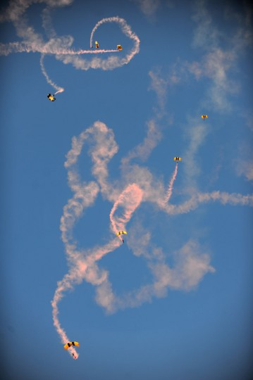 Members of the Golden Knights parachute down from several thousand feet to the 13th annual Rockin' in the Park event at Dyess Air Force Base Friday, May 1, 2015, in Abilene, Texas. (Nellie Doneva/The Abilene Reporter-News via AP)