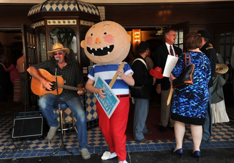 Jim Sadler, left, plays the guitar next to characters from David Shannonís books which will be featured at the CALF during the Abilene Region National Travel and Tourism Celebration Monday, May 4, 2015, in Abilene, Texas. (Nellie Doneva/The Abilene Reporter-News via AP)