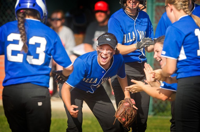Walla Walla High School's Faith Hoe, center, leads the greeting committee at home plate after her sister Lauren Hoe, #23, hit a home run in the second inning Monday afternoon, May 4, 2015, vs East Valley High School of Yakima, Wash., in Walla Walla, Wash. Walla Walla went on to a 10-0 victory in 5 innings. (Greg Lehman, Walla Walla Union-Bulletin via AP)