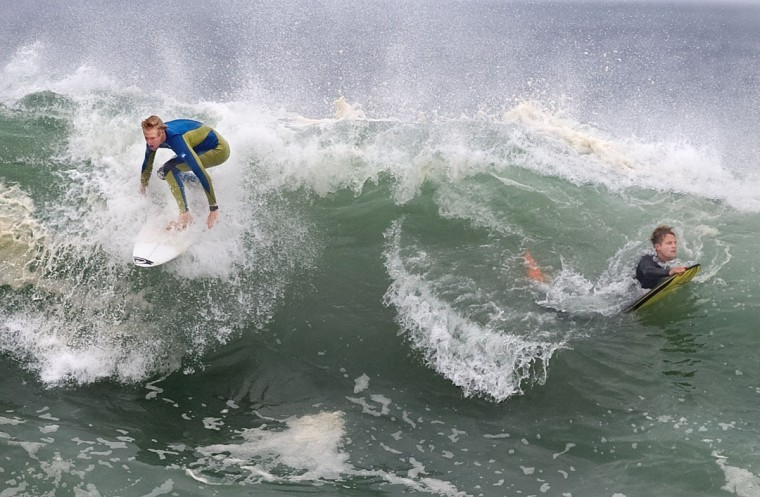 Two people surf at the Wedge in Newport Beach, Calif., Monday, May 4, 2015. (Mindy Schauer/The Orange County Register via AP)
