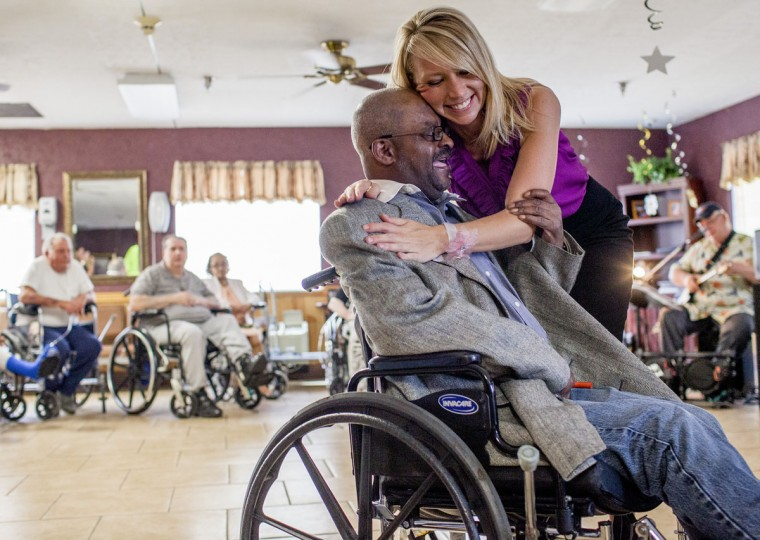 Activity Director Nolly Costello hugs resident Nate Jones after dancing with him during the Greenwood Nursing and Rehabilitation Center Senior Prom, Friday, May 15, 2015, in Bowling Green, Ky. The center hosted the prom as part of National Nursing Home Week. (Austin Anthony/Daily News via AP)