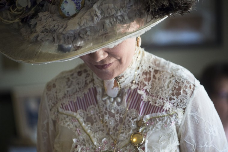 Barbara Kincaid wears a Victorian-era hat during a Victorian Tea reenactment sponsored by the Genesee Historical Society, Sunday, May 17, 2015, at the Durant Dort Carriage Company in Flint, Mich. (Zack Wittman/The Flint Journal-MLive.com via AP)