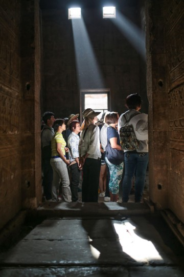 Tourists look at hieroglyphic engravings on walls inside the ancient Temple of Edfu, considered one of the best preserved Egyptian temples, which was built around 3000 years ago, near Aswan, southern Egypt, Friday, May 1, 2015. (AP Photo/Mosa'ab Elshamy)