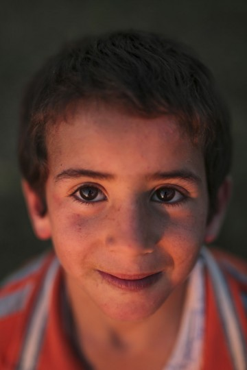 Abdo, 3, poses for a portrait while playing outsider his home in the Nile Delta town of Behira, 300 kilometers (186 miles) north of Cairo, Egypt, Wednesday, May 6, 2015. (AP Photo/Mosa'ab Elshamy)