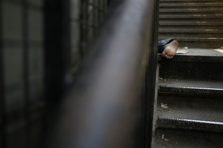 The foot of a homeless Egyptian boy is seen as he sleeps under a bridge in Cairo, Egypt, Friday, May 15, 2015. One of Egypt's worst problems is homelessness _an ongoing issue that has left thousands of Egyptians sleeping on sidewalks before and after the political and social turmoil. (AP Photo/Hassan Ammar)