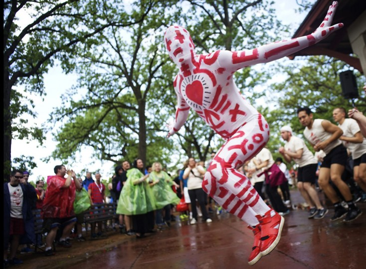 Doug Melroe, wearing a Keith Haring-inspired suit made by his partner, helps walkers get warmed up at the start of the MN AIDS Walk 2015, held at Minnehaha Park, Sunday, May 17, 2015, in Minneapolis. (Richard Tsong-Taatarii/Star Tribune via AP)