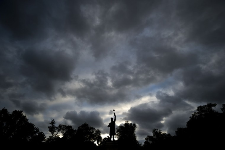 The statue of Stephen the Great, or Stefan cel Mare, in Romanian, is silhouetted against a cloudy sky in Chisinau, the capital city of Moldova, Thursday, May 28, 2015. (AP Photo/Vadim Ghirda)