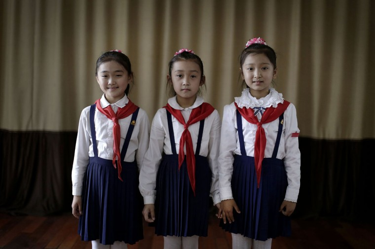 Sin Ji Ye, 9, left, An Rye Jong, 10, center, and Kim Ye Yon, 8, right, who all want to grow up to become professional singers, attend a singing class which they have been taking for two, four and one year respectively, Thursday, May 7, 2015 in Pyongyang, North Korea. The Pyongyang School Children's Palace, which opened in 1963 is a place where talented school children go to learn extra curricular activities, and is also one of the places that tourists visit while in Pyongyang. (AP Photo/Wong Maye-E)