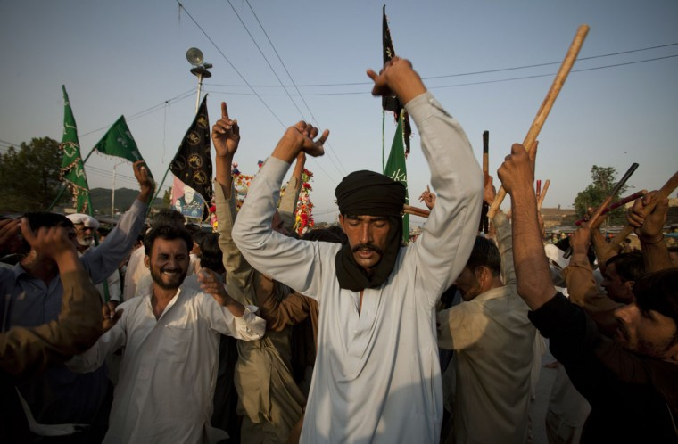 Pakistani Muslim devotees perform a traditional dance Dhamal as they arrive at Bari Imam Shrine in Islamabad, Pakistan, Thursday, May 28, 2015. Hundreds of Muslim devotees from across the country participated in the festival to pay homage to famous South Asian Saint Shah Latif Bari Qadri, also known as Bari Imam, who spread Islam in the region. (AP Photo/B.K. Bangash)