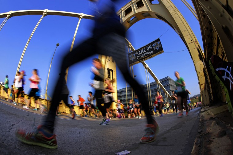 Runner's in the Pittsburgh Marathon cross the Rachel Carson Bridge in downtown Pittsburgh Sunday, May 3, 2015. (AP Photo/Gene J. Puskar)