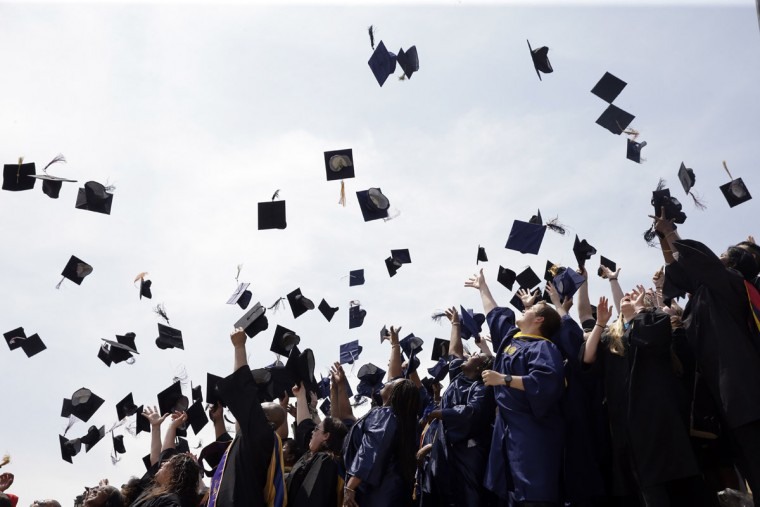 Newly minted local college graduates take part in the annual Toss Your Caps class photo Friday, May 8, 2015, on the steps of the Philadelphia Museum of Art in Philadelphia. (AP Photo/Matt Rourke)