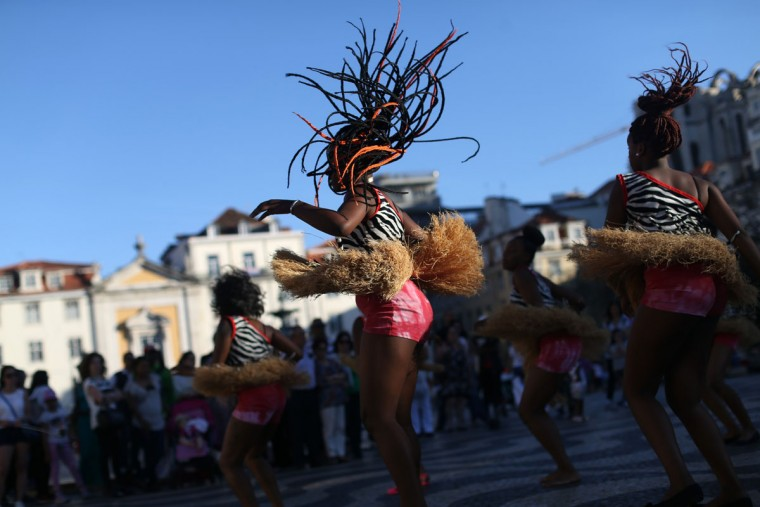 Young dancers from the Sankofa Black Gold dance association perform at the Rossio square in downtown Lisbon, Saturday, May 16, 2015. The association began in Amadora, outside Lisbon, 34 years ago to promote African dance style and music. (AP Photo/Francisco Seco)